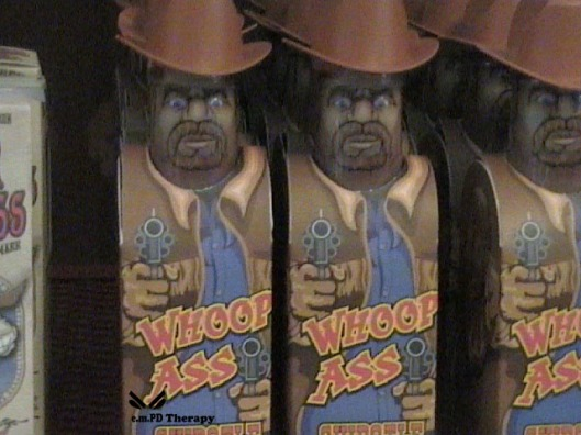 Cans of Whoopass on the shelf