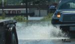 Truck cruising through flood area