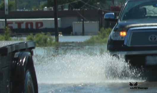 Truck cruising through flood area