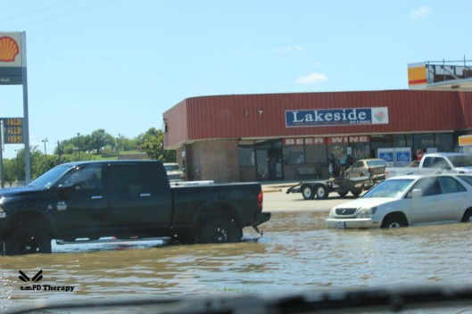Cars sitting in flood waters